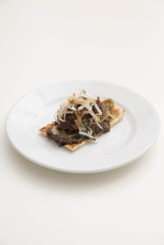 Dusty Knuckle's slice with Lia's smoked auberine dip, Phi's mushroom ketchup and Oriel Jones's slow cooked mutton