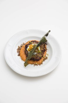 Anna Loka's Mixed vegetable rosti in a butternut marinara and crispy fried greens